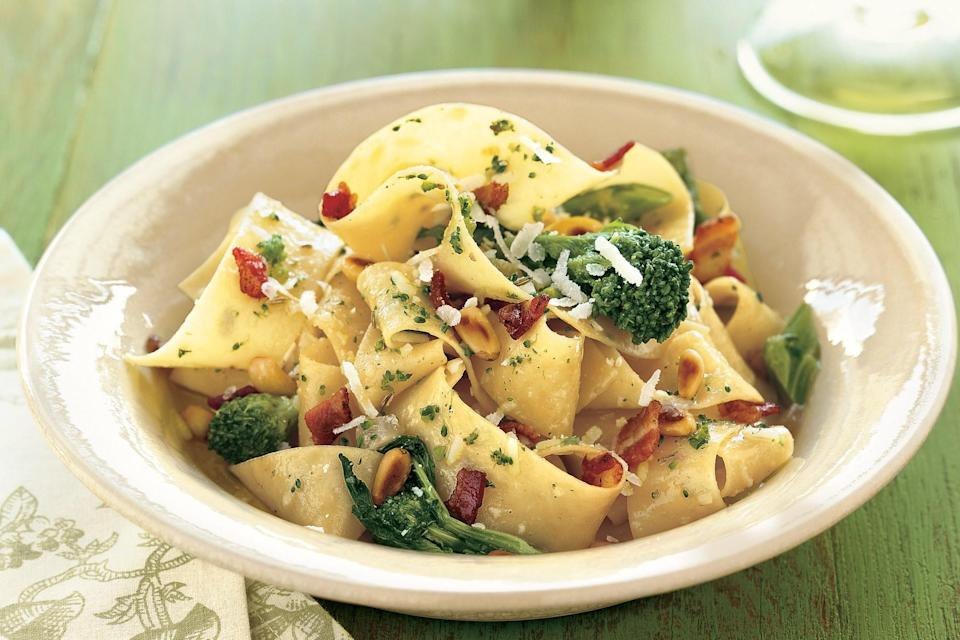 "A luxurious but simple combination of pine nuts, broccoli rabe, and crisp pancetta transforms a bowl of ribbon-like pasta. <a href=""https://www.epicurious.com/recipes/food/views/pappardelle-with-pancetta-broccoli-rabe-and-pine-nuts-234397?mbid=synd_yahoo_rss"" rel=""nofollow noopener"" target=""_blank"" data-ylk=""slk:See recipe."" class=""link rapid-noclick-resp"">See recipe.</a>"