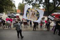 A supporter waves a flag during a rally for pop star Britney Spears during a conservatorship case hearing at Stanley Mosk Courthouse in Los Angeles