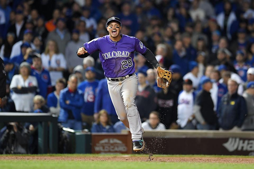 Nolan Arenado and the Rockies are finalizing a massive contract extension that would give him baseball's highest annual salary. (Photo by Stacy Revere/Getty Images)