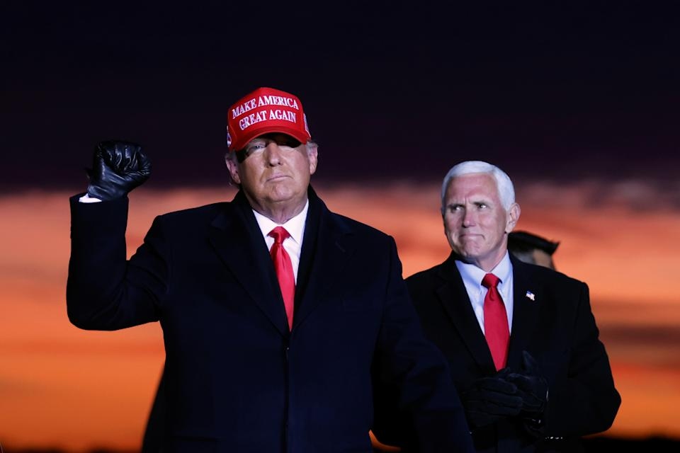 U.S. President Donald Trump and Vice President Mike Pence attend a campaign rally at Cherry Capital Airport in Traverse City, Michigan, U.S., November 2, 2020. REUTERS/Carlos Barria