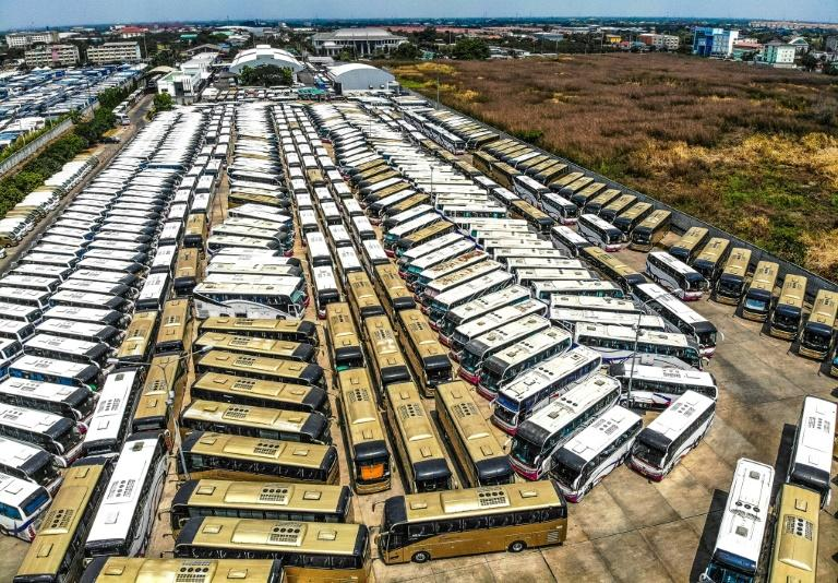 Idle tourist buses parked on a lot near Suvarnabhumi Airport in Bangkok
