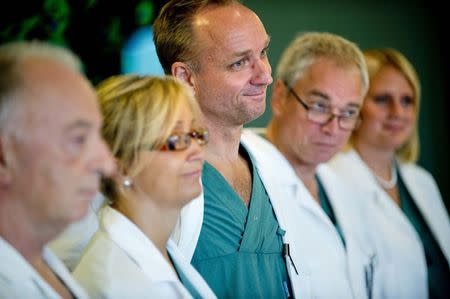 Professor Mats Brannstrom (C), head of a medical team which performed its first uterus transplant on a patient, attends a news conference about the procedure at the Sahlgreska University Hospital in Gothenburg September 18, 2012. REUTERS/Adam Ihse/TT News Agency