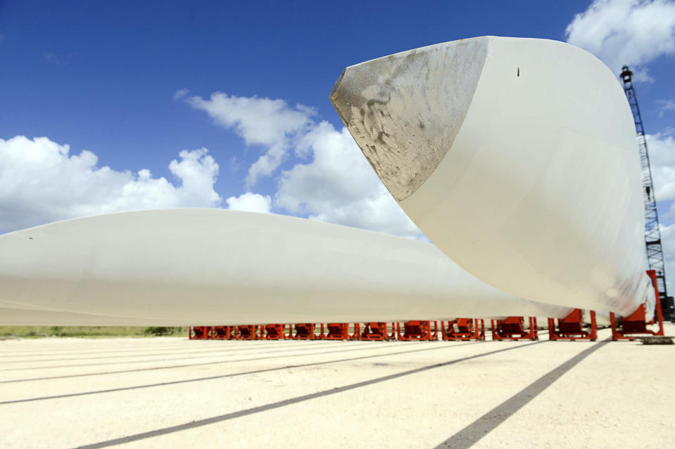 FILE - This July 29, 2016 file photo shows wind turbine blades at the Port of Brownsville, Texas. On Friday, June 25, 2021, the Associated Press reported on stories circulating online incorrectly claiming a photo shows a wind turbine that melted in the Texas heat. (Jason Hoekema/The Brownsville Herald via AP)