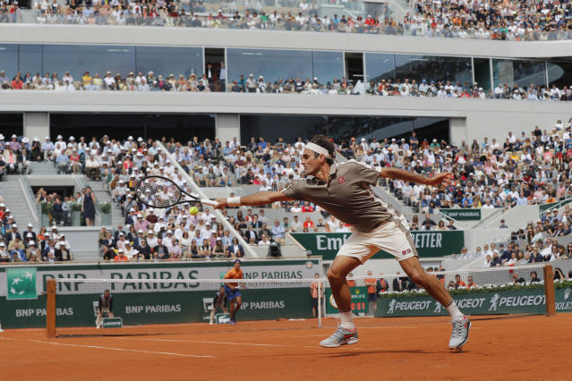 Switzerland's Roger Federer plays a shot against Italy's Lorenzo Sonego during their first round match of the French Open tennis tournament at the Roland Garros stadium in Paris, Sunday, May 26, 2019. (AP Photo/Michel Euler )
