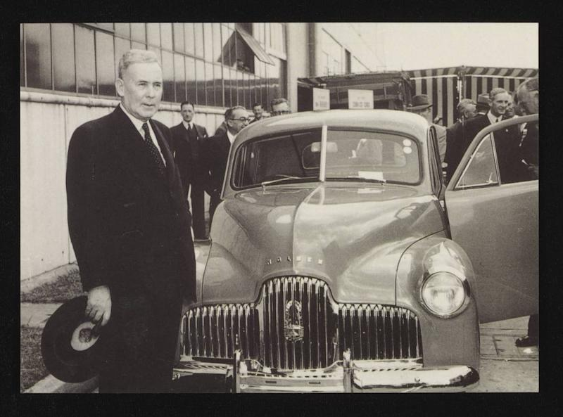 Pictured: Prime Minister Ben Chifley with the unveiling of the first Holden.