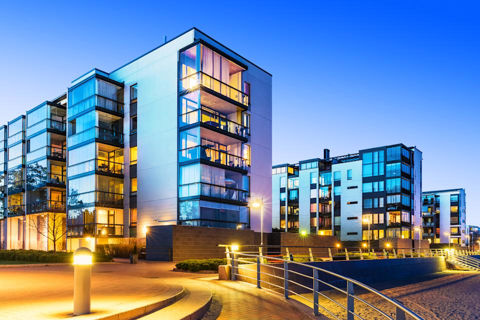 House building and city construction concept: evening outdoor urban view of modern real estate homes. See also: