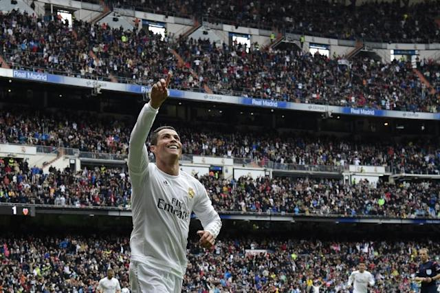 Real Madrid's forward Cristiano Ronaldo celebrates after scoring a goal during the Spanish league football match Real Madrid CF vs Valencia CF at the Santiago Bernabeu stadium in Madrid on May 8, 2016 (AFP Photo/Javier Soriano)