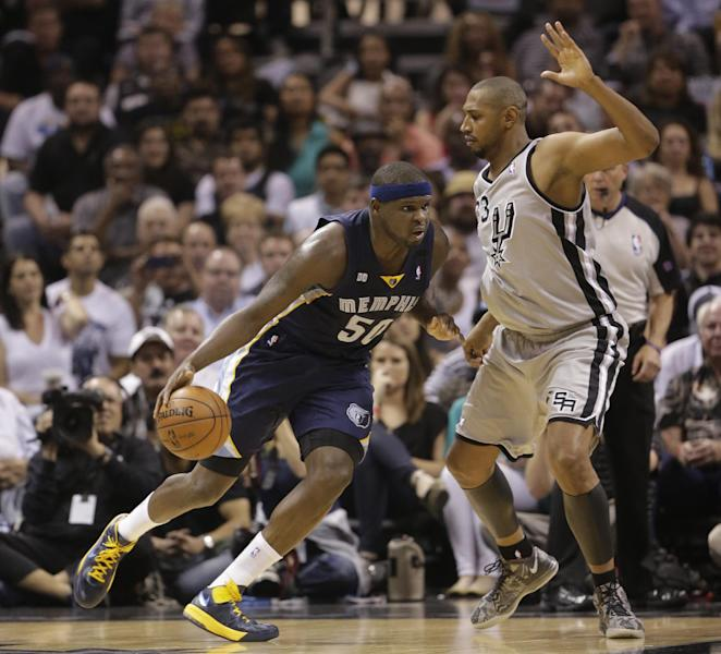 Memphis Grizzlies' Zach Randolph (50) drives the ball against San Antonio Spurs' Boris Diaw (33), of France, during the first half in Game 2 of the Western Conference finals NBA basketball playoff series, Tuesday, May 21, 2013, in San Antonio. (AP Photo/Eric Gay)