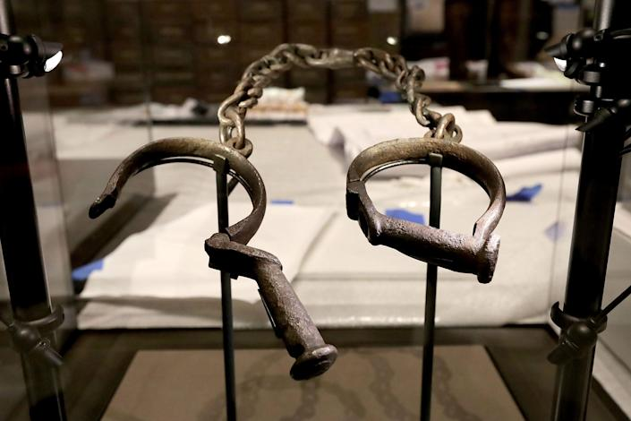 A pair of slave shackles are on display in the Slavery and Freedom Gallery in the Smithsonian's National Museum of African American History and Culture.