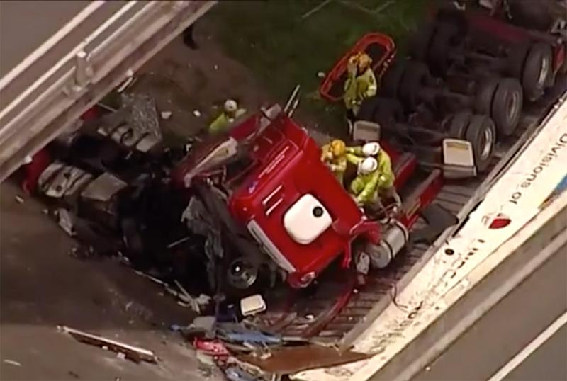 A Queensland woman claims a triple-zero operator fobbed off her call about a truck crash off the Logan Motorway (pictured)