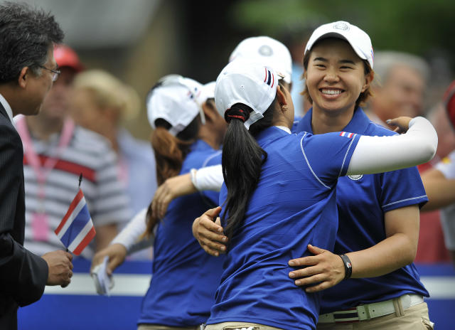 Onnarin Sattayabanphot, right, is hugged by Pornanong Phatlum, both of Thailand, hug before the first round of the International Crown LPGA golf tournament Thursday, July 24, 2014, in Owings Mills, Md.(AP Photo/Gail Burton)