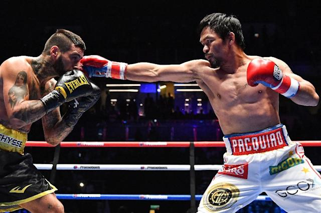 Pacquiao registered the 60th win of a fabled 23-year career (AFP Photo/Mohd RASFAN)