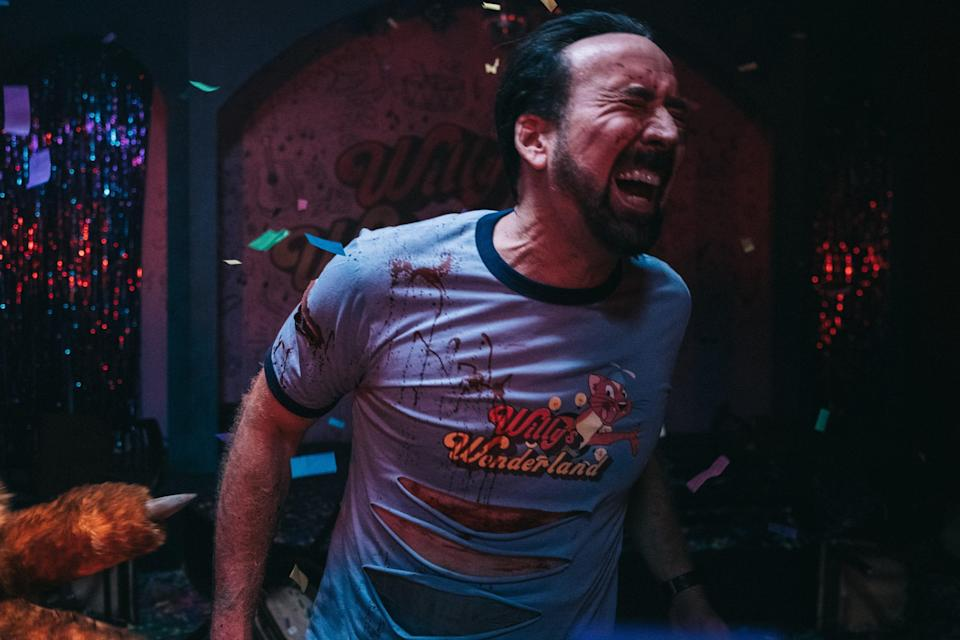 """The Janitor (Nicolas Cage) battles a giant singing weasel and other evil animatronic robots in """"Willy's Wonderland."""""""