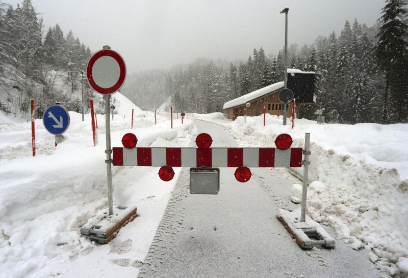Due to the danger of an avalanche a mountain pass road is closed in Obermaiselstein, Germany, Sunday, Jan. 13, 2019. (Karl-Josef Hildenbrand/dpa via AP)
