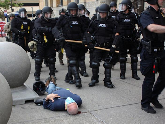 <p>Martin Gugino, a 75-year-old protester, lays on the ground after he was shoved by two Buffalo, New York, police officers during a protest against the death in Minneapolis police custody of George Floyd in Niagara Square in Buffalo, New York, on 4 June 2020</p> ((Mike Desmond - WBFO))