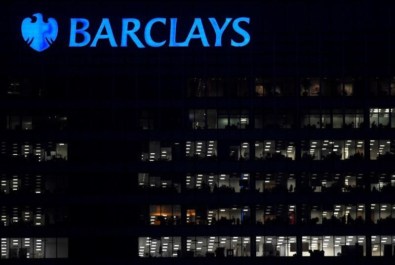 FILE PHOTO: Workers are seen in at Barclays bank offices in the Canary Wharf financial district in London