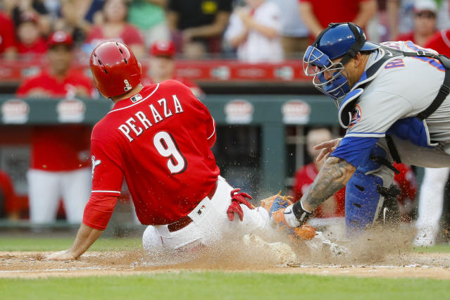 Cincinnati Reds' Jose Peraza (9) is tagged out at home by New York Mets catcher Wilson Ramos in the eighth inning of a baseball game, Saturday, Sept. 21, 2019, in Cincinnati. (AP Photo/John Minchillo)