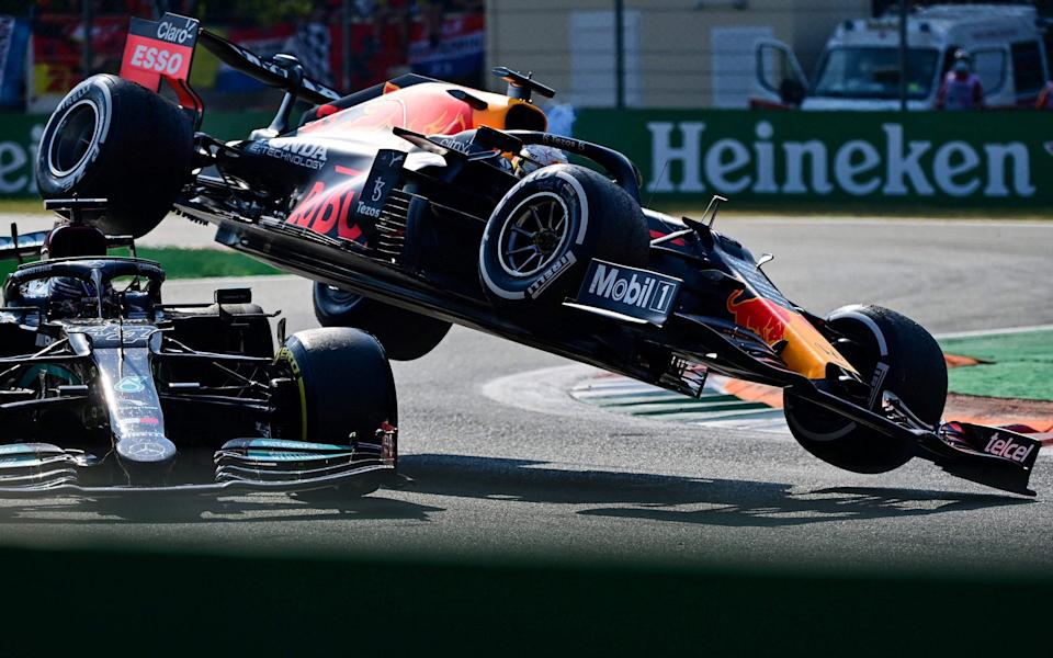 Mercedes' British driver Lewis Hamilton (L) and Red Bull's Dutch driver Max Verstappen collide during the Italian Formula One Grand Prix at the Autodromo Nazionale circuit in Monza, on September 12, 2021 - AFP