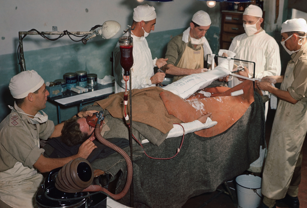 <p>A wounded British soldier receives a blood transfusion in Italy, 1944 (Picture: PA) </p>
