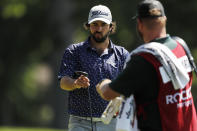 Mark Hubbard walks off the 14th green during the second round of the Rocket Mortgage Classic golf tournament, Friday, July 3, 2020, at the Detroit Golf Club in Detroit. (AP Photo/Carlos Osorio)