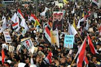 Iraqi demonstrators rally to mourn Iranian general Qasem Soleimani and an Iraqi paramilitary leader a year after they were killed in a US drone strike
