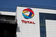 The logo of French oil and gas company Total is seen in Rueil-Malmaison