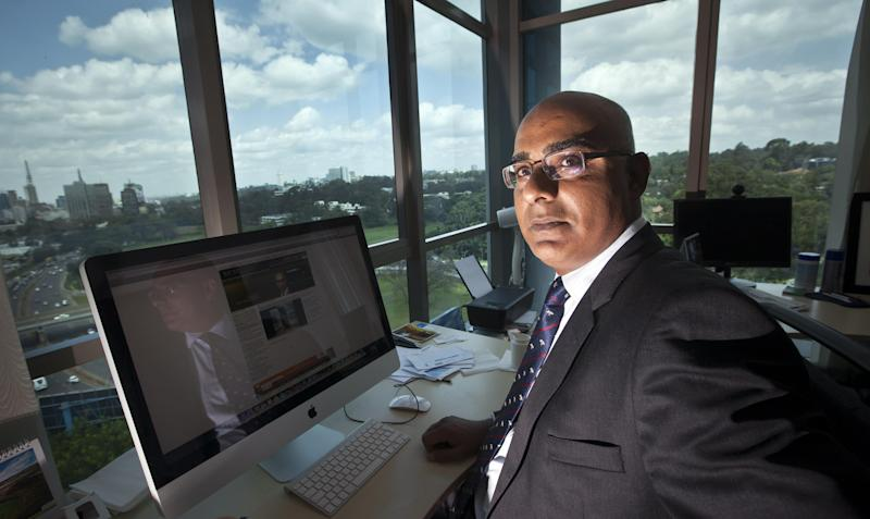 In this photo taken Thursday, May 16, 2013, Aly-Khan Satchu, the Chief Executive Officer of RICH Management Ltd, poses for a photograph in his office overlooking the skyline of Nairobi, Kenya. The barrage of hourly tweets sent out by Aly-Khan Satchu, East Africa's version of CNBC's Mad Money host Jim Cramer, cheers on what Satchu says is a growing sentiment among investors: If you're not investing in Africa, you should be. (AP Photo/Ben Curtis)