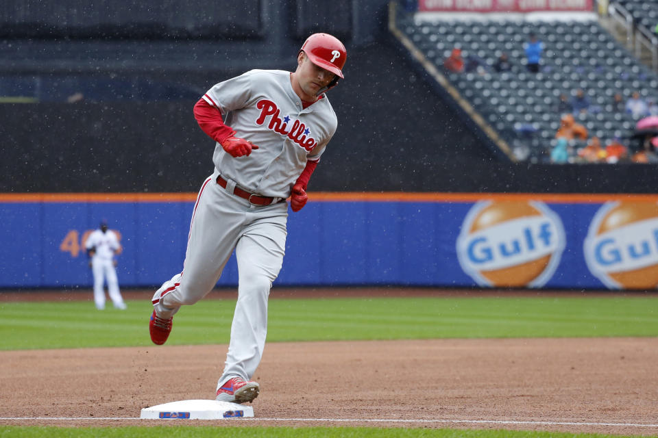 Philadelphia Phillies' Rhys Hoskins rounds third base after hitting a two-run home run in the first inning of a baseball game against the New York Mets, Sunday, Sept. 9, 2018, in New York. (AP Photo/Mark Lennihan)