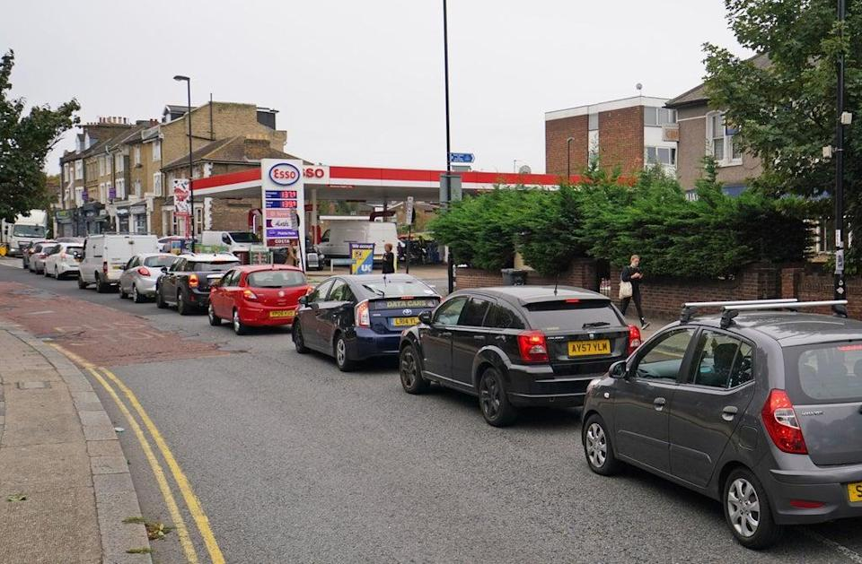 Motorists queue for petrol at an Esso petrol station in Brockley, South London. (PA)