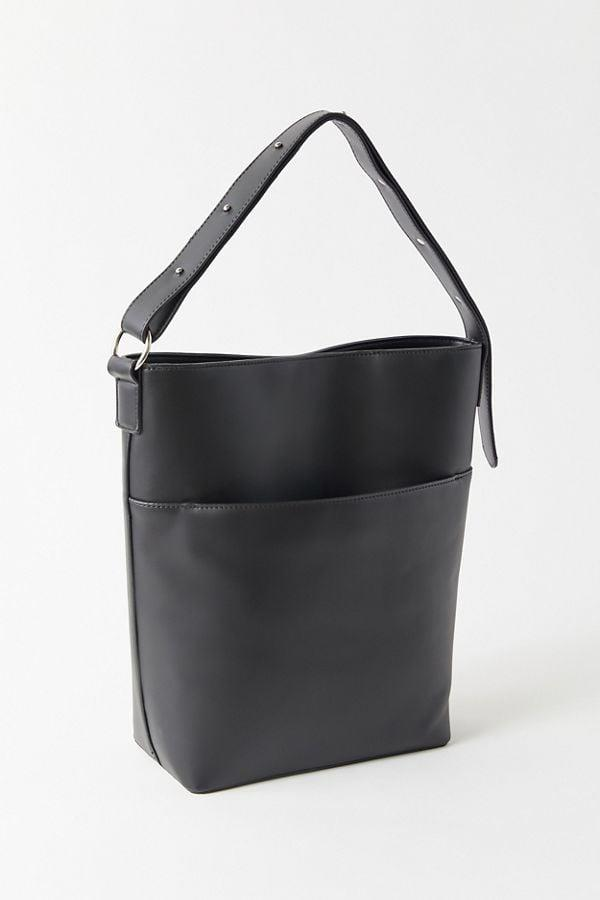 """<p>The front pocket on this <a href=""""https://www.popsugar.com/buy/Mia-Structured-Shoulder-Bag-537109?p_name=Mia%20Structured%20Shoulder%20Bag&retailer=urbanoutfitters.com&pid=537109&price=25&evar1=fab%3Aus&evar9=45623846&evar98=https%3A%2F%2Fwww.popsugar.com%2Ffashion%2Fphoto-gallery%2F45623846%2Fimage%2F47066448%2FMia-Structured-Shoulder-Bag&list1=shopping%2Caccessories%2Cbags%2Cworkwear&prop13=mobile&pdata=1"""" rel=""""nofollow"""" data-shoppable-link=""""1"""" target=""""_blank"""" class=""""ga-track"""" data-ga-category=""""Related"""" data-ga-label=""""https://www.urbanoutfitters.com/shop/mia-structured-shoulder-bag?category=SEARCHRESULTS&amp;color=001"""" data-ga-action=""""In-Line Links"""">Mia Structured Shoulder Bag</a> ($25, originally $49) is so useful.</p>"""