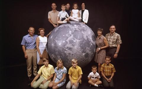 The Apollo 11 astronauts: Buzz Aldrin (left), Michael Collins (top) and Neil Armstrong (right), photographed with their wives and children - Credit: GETTY IMAGES