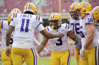 LSU running back Tyrion Davis-Price (3) celebrates with teammates after scoring a touchdown against Arkansas during the first half of an NCAA college football game Saturday, Nov. 21, 2020, in Fayetteville, Ark. (AP Photo/Michael Woods)