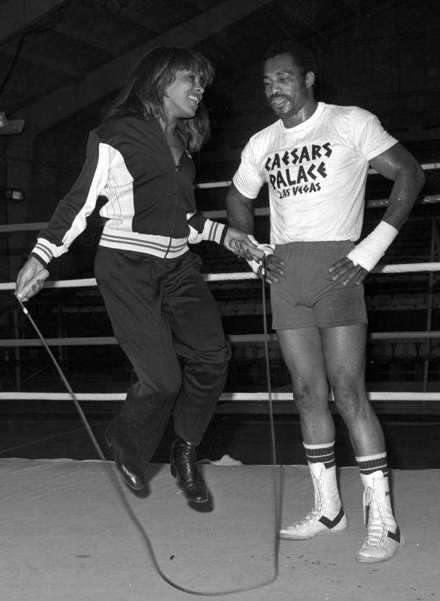 In this 1977 photo provided by the Las Vegas News Bureau, former heavyweight boxing champion Ken Norton helps Tina Turner jump rope in the ring at Caesars Palace in Las Vegas. Norton, who beat Muhammad Ali and later lost a controversial decision to him in Yankee Stadium, died Wednesday, Sept. 18, 2013, at a Las Vegas care facility, his son said. He was 70. (AP Photo/Las Vegas News Bureau)