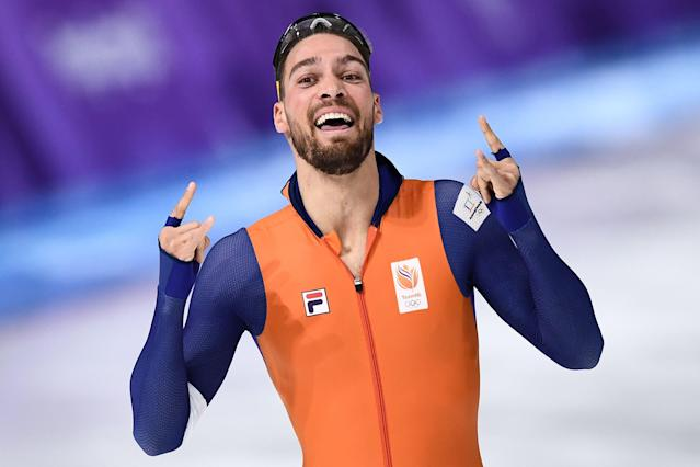 <p>Netherlands' Kjeld Nuis celebrates after winning the Men's 1,000m Speed Skating event during the PyeongChang 2018 Winter Olympic Games, February 23, 2018.<br> (Photo by Aris Messinis/AFP/Getty Images) </p>