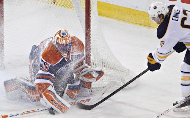 Buffalo Sabres' Tyler Ennis (63) is stopped by Edmonton Oilers goalie Ben Scrivens (30) during the second period of an NHL hockey game in Edmonton, Alberta, on Thursday, March 20, 2014. (AP Photo/The Canadian Press, Jason Franson)