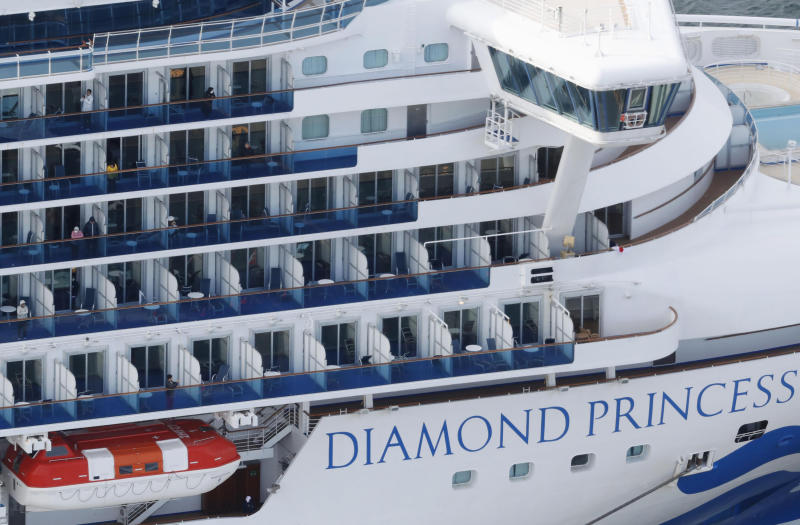 Some passengers are seen on the Diamond Princess as the cruise ship is anchored at Yokohama Port for supplies replenished in Yokohama, south of Tokyo.