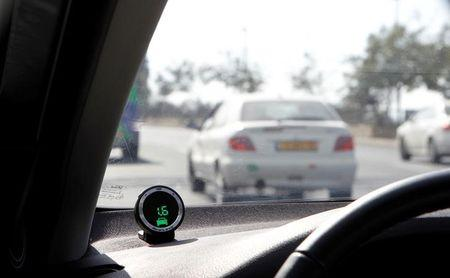 A device, part of the Mobileye driving assist system, is seen on the dashboard of a vehicle during a demonstration for the media in Jerusalem October 24, 2012. REUTERS/Baz Ratner/File Photo