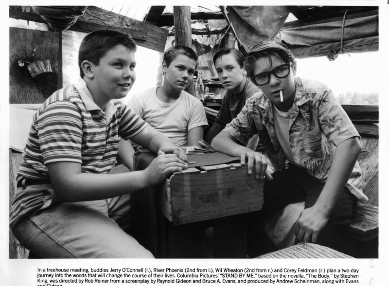 Jerry O'Connell, River Phoenix, Wil Wheaton, and Corey Feldman are gathered around together in a scene from the film 'Stand By Me', 1986. (Photo by Columbia Pictures/Getty Images)