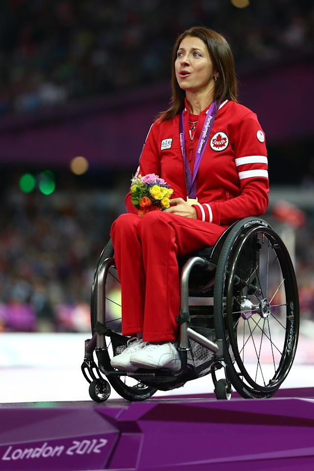 LONDON, ENGLAND - SEPTEMBER 01: Gold medalist Michelle Stilwell of Canada poses on the podium during the medal ceremony in the Women's 200m - T52 on day 3 of the London 2012 Paralympic Games at Olympic Stadium on September 1, 2012 in London, England. (Photo by Michael Steele/Getty Images)