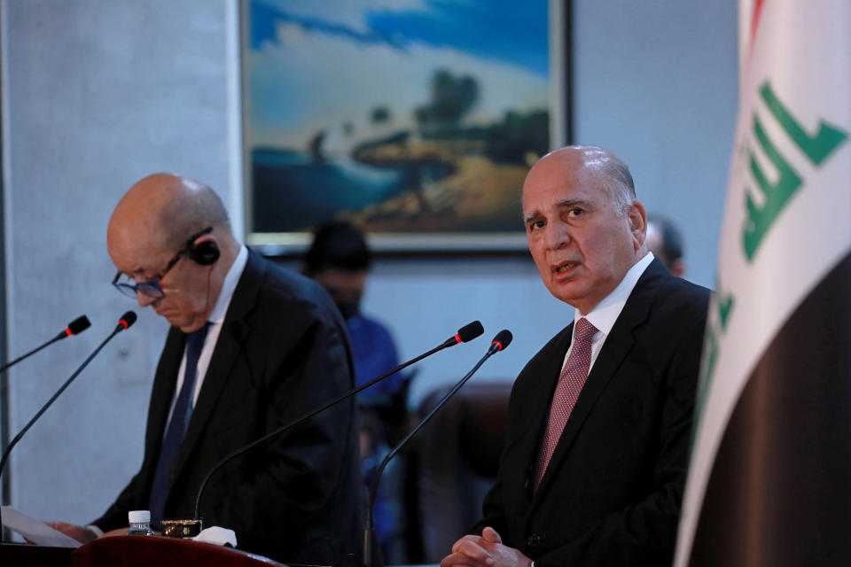 Iraqi Foreign Minister Fouad Hussein, right, and visiting French counterpart Jean-Yves Le Drian, hold a news conference following their meeting in Baghdad, Iraq, Thursday, July 16, 2020. (AP Photo/Hadi Mizban)