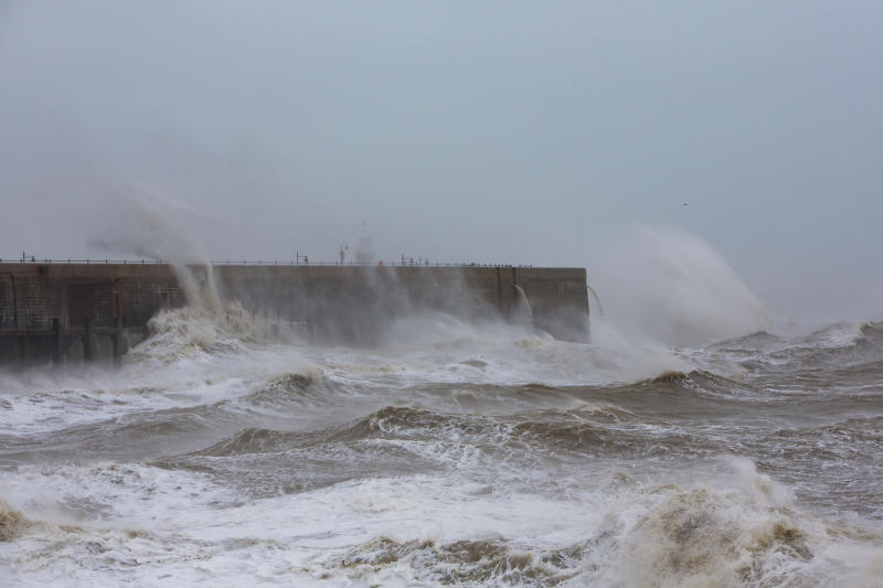 Waves cresting over Folkstone Harbour Arm as Storm Ciara swept in on February 9th 2020 in Folkestone, United Kingdom. Amber weather warnings were put into place by the MET office as gusts of up to 90mph and heavy rain swept across the UK. An amber warning from the MET office expects a powerful storm that will disrupt air, rail and sea links travel, cancel sports events, cut electrical power and damage property. (photo by Andrew Aitchison / In pictures via Getty Images)