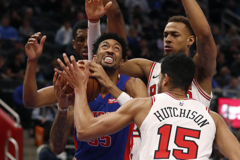 Detroit Pistons forward Christian Wood (35) is pressured by Chicago Bulls forwards Thaddeus Young, left, Daniel Gafford, back right, and forward Chandler Hutchison (15) during the first half of an NBA basketball game, Saturday, Jan. 11, 2020, in Detroit. (AP Photo/Carlos Osorio)