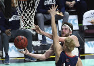 Gonzaga forward Drew Timme (2) lays up the ball against Saint Mary's the during the first half of an NCAA semifinal college basketball game at the West Coast Conference tournament Monday, March 8, 2021, in Las Vegas. (AP Photo/David Becker)