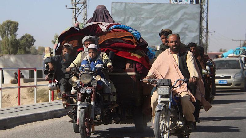 Tens of thousands flee Taliban attacks in southern Afghanistan as peace talks stall