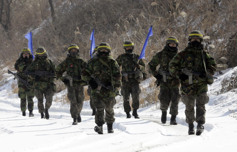 South Korean army soldiers walk on a snow covered road during an exercise near the border village of Panmunjom, which has separated the two Koreas since the Korean War, in Paju, north of Seoul, South Korea, Wednesday, Feb. 13, 2013. Defying U.N. warnings, North Korea on Tuesday conducted its third nuclear test in the remote, snowy northeast, taking a crucial step toward its goal of building a bomb small enough to be fitted on a missile capable of striking the United States. (AP Photo/Lee Jin-man)