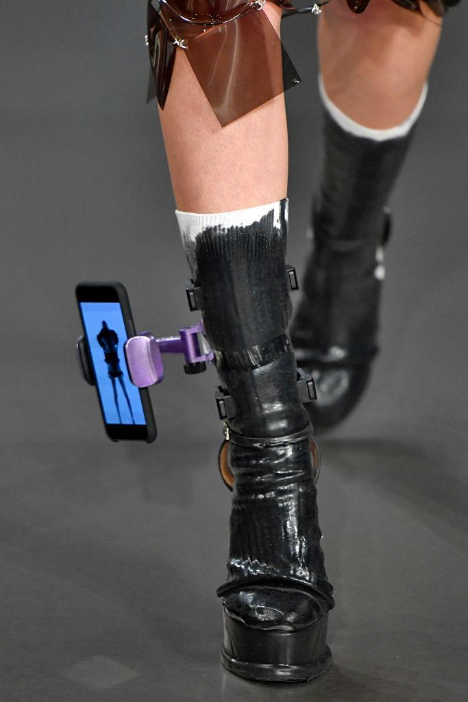 <p>A close-up of the cellphone holder that a model wore on his leg during the Maison Margiela Spring/Summer 2019 runway show. (Photo by Victor Virgile/Gamma-Rapho via Getty Images) </p>
