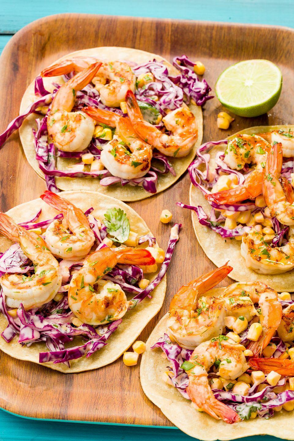 "<p>Smoky, grilled shrimp and spicy slaw are the keys to next-level tacos.</p><p>Get the recipe from <a href=""https://www.delish.com/cooking/recipe-ideas/recipes/a47499/grilled-shrimp-tacos-with-sriracha-slaw-recipe/"" rel=""nofollow noopener"" target=""_blank"" data-ylk=""slk:Delish"" class=""link rapid-noclick-resp"">Delish</a>.</p>"