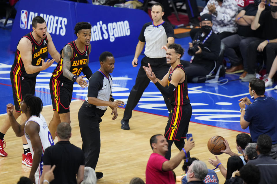 Atlanta Hawks' Trae Young, right, reacts to a call during the second half of Game 7 in a second-round NBA basketball playoff series against the Philadelphia 76ers, Sunday, June 20, 2021, in Philadelphia. (AP Photo/Matt Slocum)