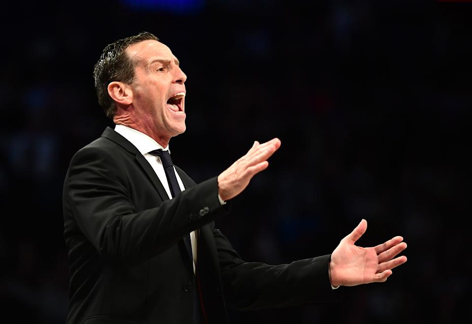 Nets head coach Kenny Atkinson used a cue card in Friday's game to help with defensive playcalling. (Emilee Chinn/Getty Images)