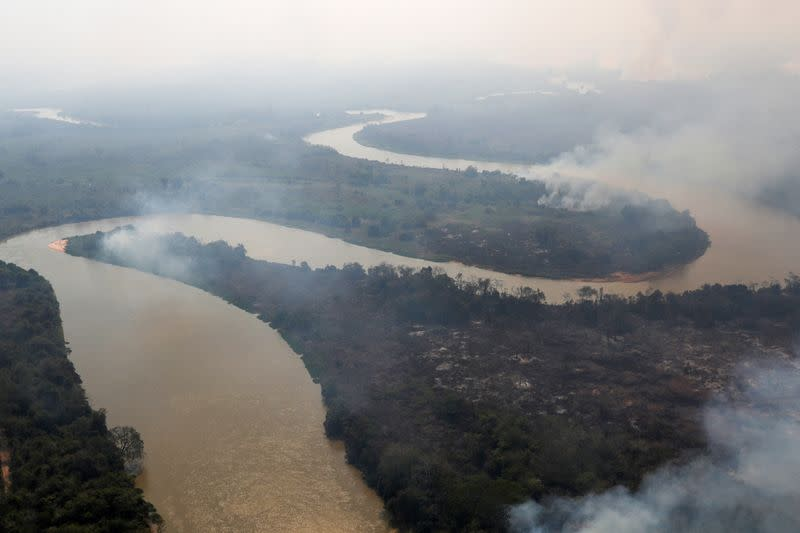 Smoke from a fire is seen near Cuiaba River at Pantanal, in Pocone